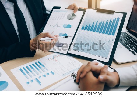 Business people discussing with colleagues with entrepreneurs are planning finance in office room. #1416519536