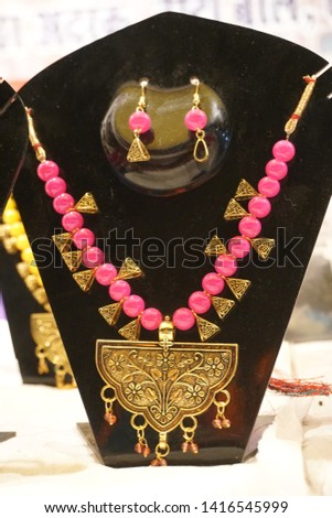 Hand made beautiful coral necklaces on display stand with selective focus. #1416545999