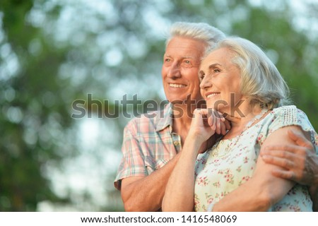 Beautiful senior couple hugging in the summer park #1416548069