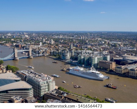 London, UK, England - 8/02/2019:  This aerial view shows Tower Bridge, River Thames, a white cruise ship and HMS Belfast with City Hall behind #1416564473