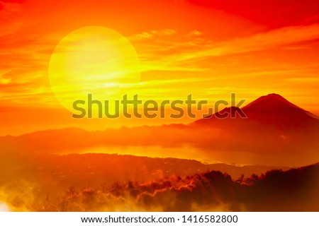 African landscape with mountains silhouettes and sunset