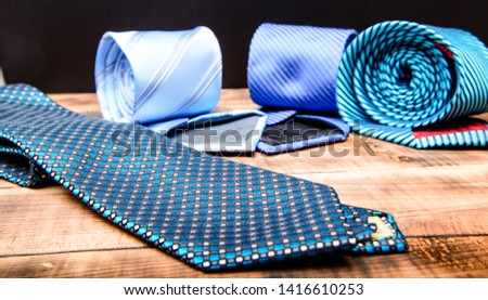 Perfect necktie close up. Shopping concept. Personal stylist service. Stylist advice. Matching necktie with outfit. Pick necktie. Different blue color necktie. Menswear clothes and accessories. #1416610253