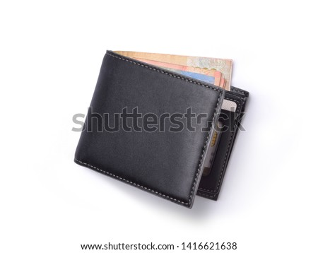 Top view of New black genuine leather wallet with banknotes and credit card inside isolated on white background. Royalty-Free Stock Photo #1416621638