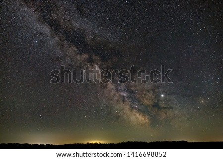 Stars in the sky at night. Bright milky way over the horizon. Photographed with a long exposure. #1416698852
