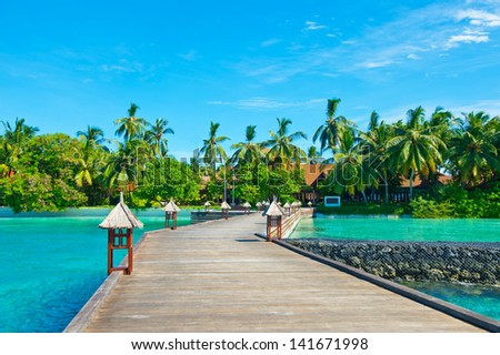 Scenic view on tropical island with turquoise water and blue sky #141671998