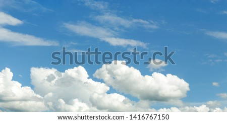 Blue sky with fluffy clouds at sunny summer day without ground for backdrop. #1416767150