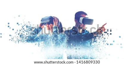 A man and a woman in glasses of virtual reality. The concept of modern technologies and technologies of the future. Fragmented by pixels. VR glasses. #1416809330