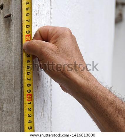 Measure with tape measure, tape measure,                             #1416813800
