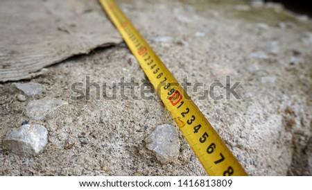Measure with tape measure, tape measure,                             #1416813809