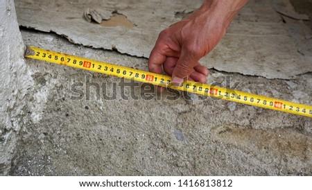 Measure with tape measure, tape measure,                             #1416813812