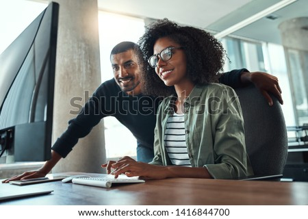 Two professional business people working together in office Royalty-Free Stock Photo #1416844700