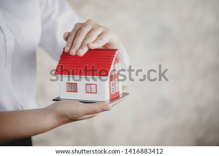 protection or in salesman person giving to buyer customer, house in hand  #1416883412