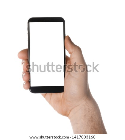 Man holding smartphone with blank screen on white background, closeup of hand. Space for text #1417003160