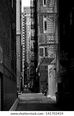 Chicago Downtown Alley in Black and White Vertical Photography. Urban Photo Collection. Chicago, Illinois, USA. #141703459