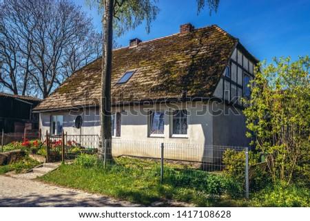 Lacko, Poland - May 13, 2017: Old traditional house in Lacko village within Slawno County near Baltic Sea coast #1417108628