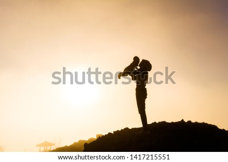 Silhouette about mother's love for her baby #1417215551