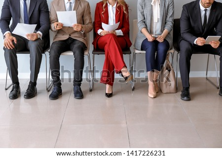 Young people waiting for job interview indoors #1417226231