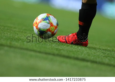 MAY 15, 2019 - ZAPORIZHYA, UKRAINE: Adidas Football, soccer Ball – Conext 19 European Qualifiers Official Game Ball close-up view dribbled by Nike boots #1417233875