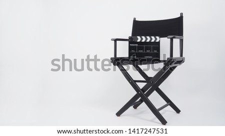 Black Clapper board or movie slate with director chair use in video production or movie and cinema industry. It's put on white background.. #1417247531