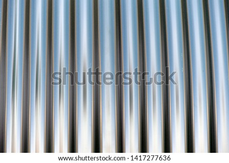 Partially view of a chrome roll. Chrome structures in a row. #1417277636