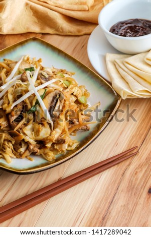 Chinese food Moo shu pork with Mandarin pancake wrappers and hoisin black bean dipping sauce #1417289042