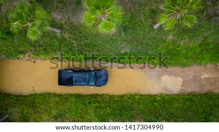 Aerial view off-road car vehicle, car 4x4 wheel drives off-road, Black truck car 4x4 adventure over river view from above. #1417304990