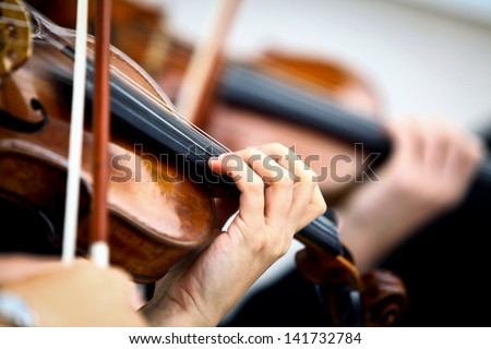 Detail of violin being played by a musician Royalty-Free Stock Photo #141732784
