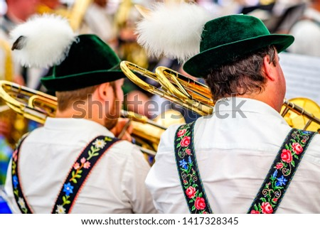 typical bavarian musician in a festival tent #1417328345