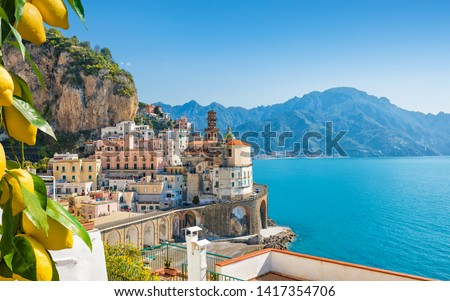 Small city Atrani on Amalfi Coast in province of Salerno, Campania region, Italy. Amalfi coast on Gulf of Salerno is popular travel and holyday destination in Italy. Ripe yellow lemons in foreground. Royalty-Free Stock Photo #1417354706