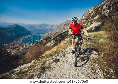 Extreme mountain bike sport athlete man riding outdoors lifestyle trail  #1417367060