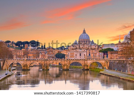 cityscape and panoramic view of old bridge with warm sunset sky water reflections and dome of St. Peters cathedral church with old buildings and architecture in Rome, Italy #1417390817