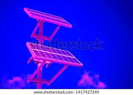Neon colored Solar panels with copy space background. Renewable Energy concept. Horizontal shot #1417427249