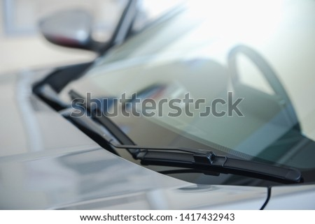 close up of car windshield rain wipers And close-up images of the windshield or windshield New cars parked in the showroom #1417432943