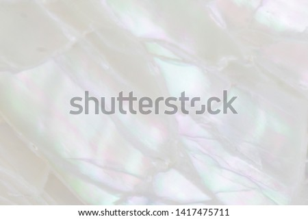 Abstract pearl background with soft shimmering mother of pearl lilac and rainbow colours #1417475711