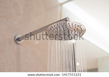 Shower turned on, overhead ceiling shower faucet head closeup. #1417551221