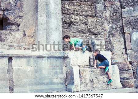 little boy exploring ancient architecture, lifestyle people on summer vacation close up #1417567547