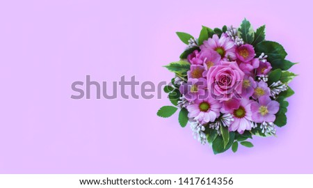 Flower arrangement with spring flowers on a purple background. Spring, summer, day. Background for greetings, invitations, cards. Bright colours. The view from the top. #1417614356