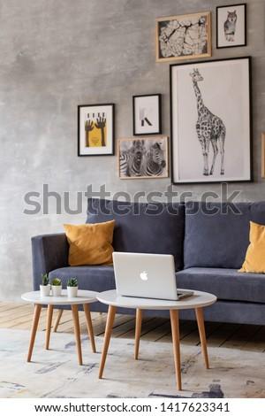 Nizhniy Novgorod, Russia - April 5, 2019: Photo studio 2.8. Scandinavian style living room with posters on the wall. #1417623341
