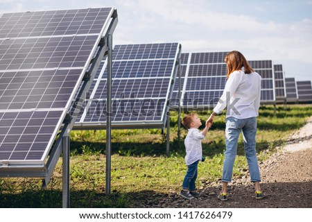 Mother with her little son by solar panels #1417626479