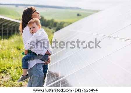 Mother with her little son by solar panels #1417626494