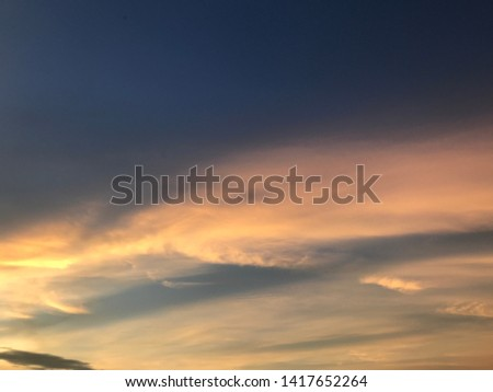 Beautiful sunset with golden sky #1417652264