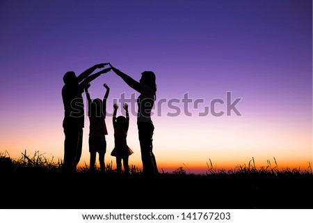 happy family making the home sign on the hill