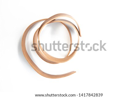 Working process of the leather belt on white background #1417842839