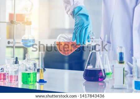 laboratory research and development concept with scientist and lab glassware #1417843436