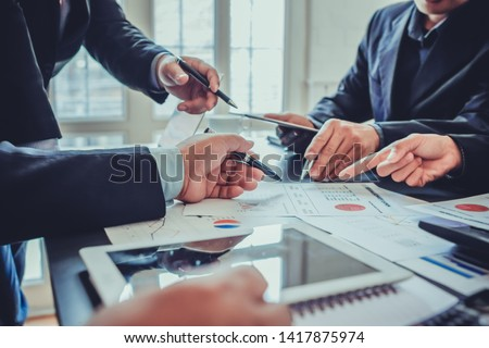 Businessmen in the meeting room are introducing and consulting each other in order to make good business profits. Concepts for advice and consultation between investors to exchange knowledge #1417875974