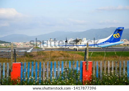 Taipei, Taiwan - Oct 21, 2018:The plane is preparing to take off on the runway. #1417877396