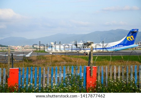 Taipei, Taiwan - Oct 21, 2018:The plane is preparing to take off on the runway. #1417877462