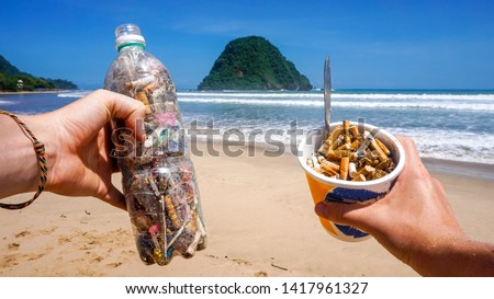 Trash collected from the pictured beach presented in single use plastic items. All rubbish found in the sand and sea. Representing the pollution in our oceans today which kills marine life worldwide #1417961327