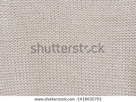 Knitted background. Knitted texture. Knitting pattern of wool. Knitting. Texture of knitted woolen fabric for wallpaper and an abstract background    #1418030792