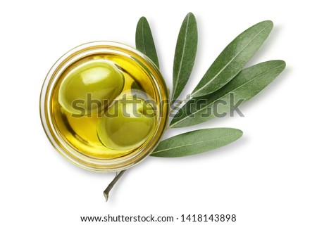 Delicious big green olives in an olive oil with leaves, isolated on white background, view from above #1418143898